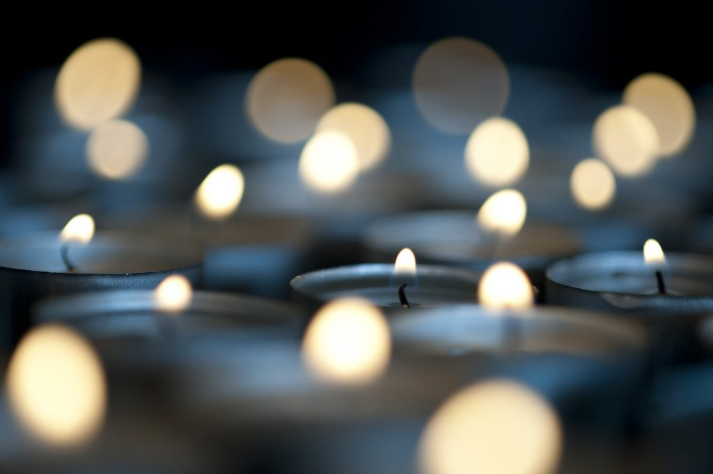 burning christmas candles pictured with a narrow depth of field
